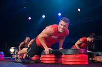 BODYPUMP™ Instructor doing push ups on SMARTSTEP™