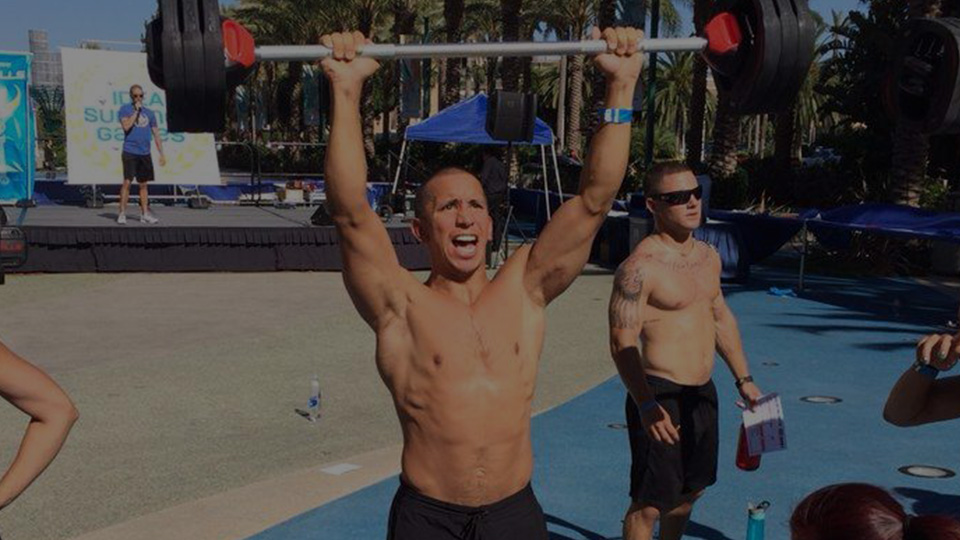 Man weight lifting on Venice Beach in Los Angeles