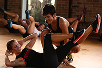 Les Mills GRIT instructor coaching crunches