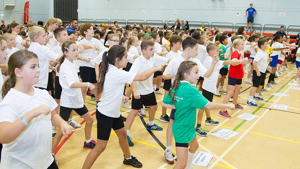 children doing a group exercise class