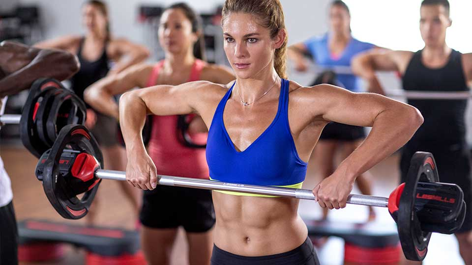 Woman in a weight lifting fitness workout