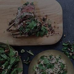 Lamb and couscous salad on wooden block