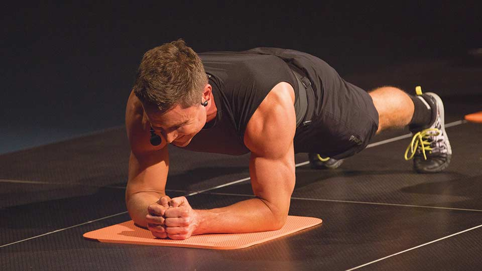 Fitness instructor demonstrating a hover