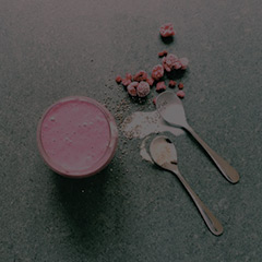 raspberry coconut smoothie with two spoons