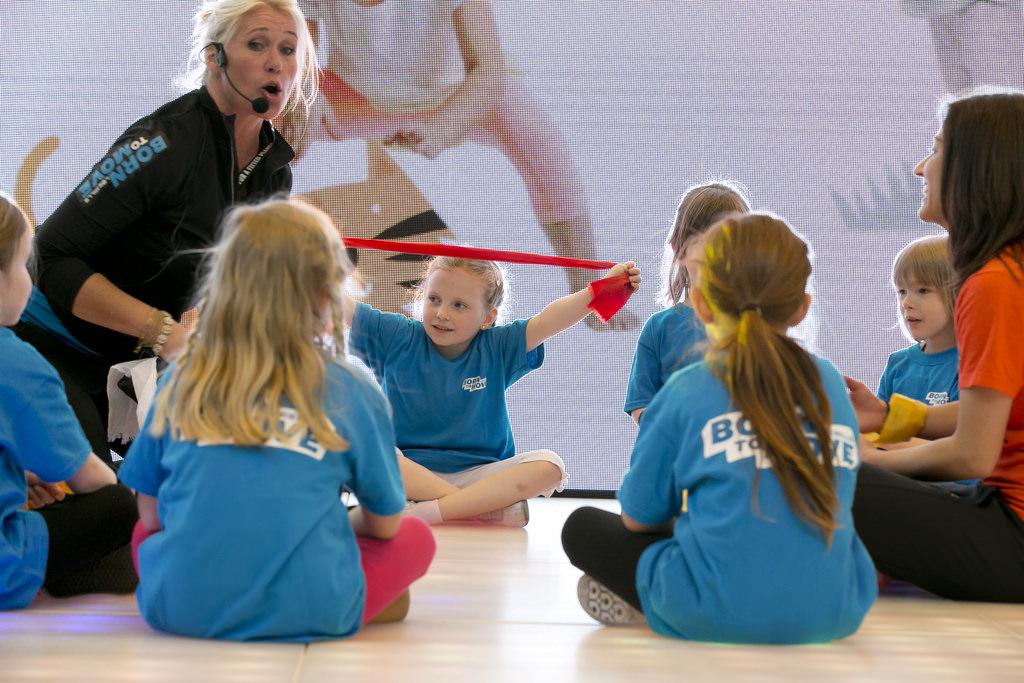 Seven children doing a fitness exercise class
