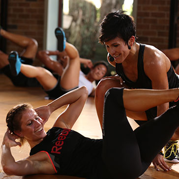 Woman being coached during Les Mills GRIT
