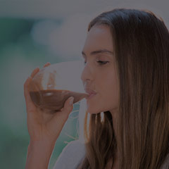 Girl drinking protein in a glass