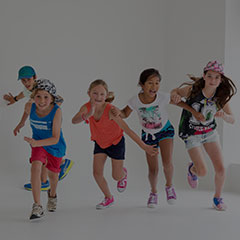 five children running in a fitness workout class