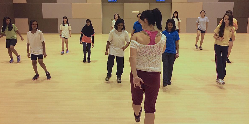 Fitness instructor hosting a class in Malaysia
