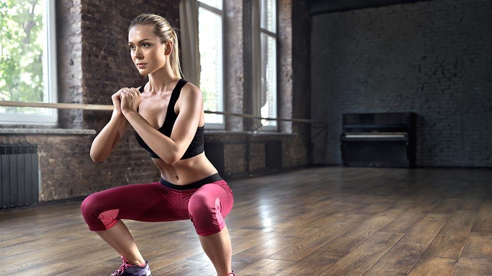 Woman at home squat
