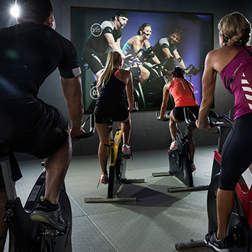 people in a cycle studio workout