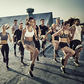 Group of people doing a GRIT CARDIO class outdoors