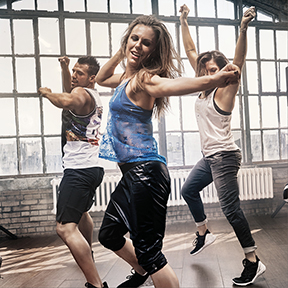 Three people in a Les Mills SH'BAM fitness class