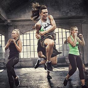 Women doing martial arts kick with class punching